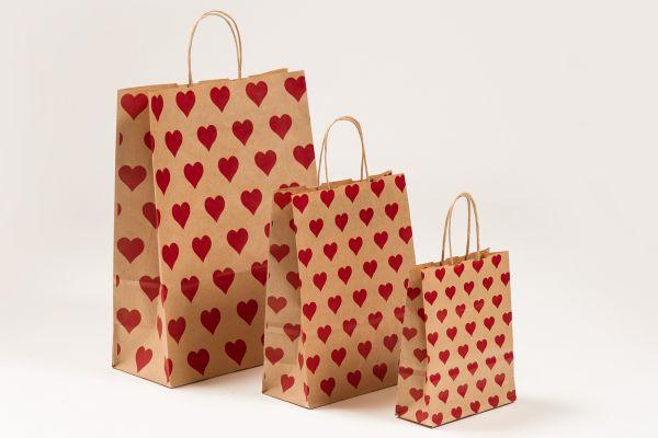 Papiertasche mit gedrehtem Papiergriff Herzen